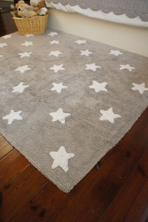The grey & white stars washable nursery rug is both stylish and functional, adding warmth to your child's room  www.urbanmummy.co.uk