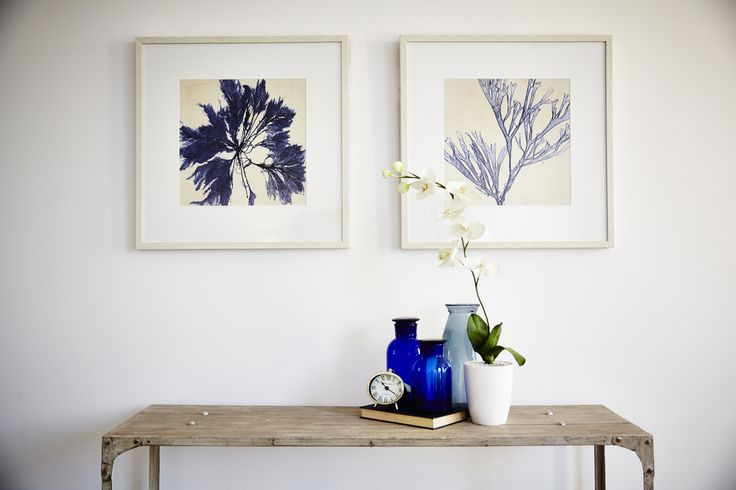 A few well placed accessories can make any room a work of art. This collection of blue and white pieces dress up this space perfectly!