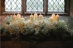 Front of church to go with baby's breath pew ends. Church wedding flowers with candles something like this on altar?