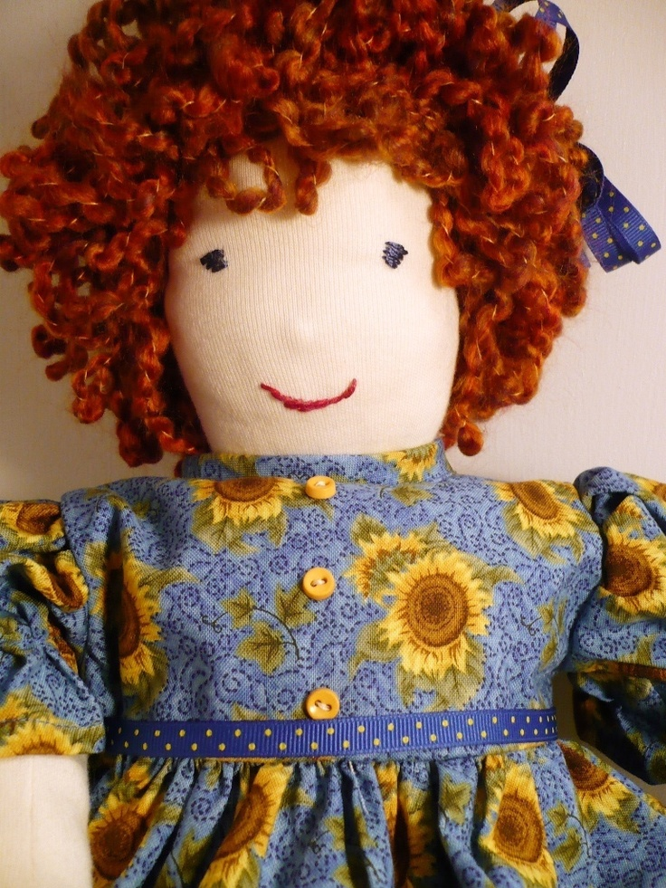 curly red head in sunflowers