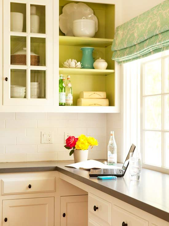 For a splash of color, these homeowners chose to paint the inside of their kitchen cabinets chartreuse.
