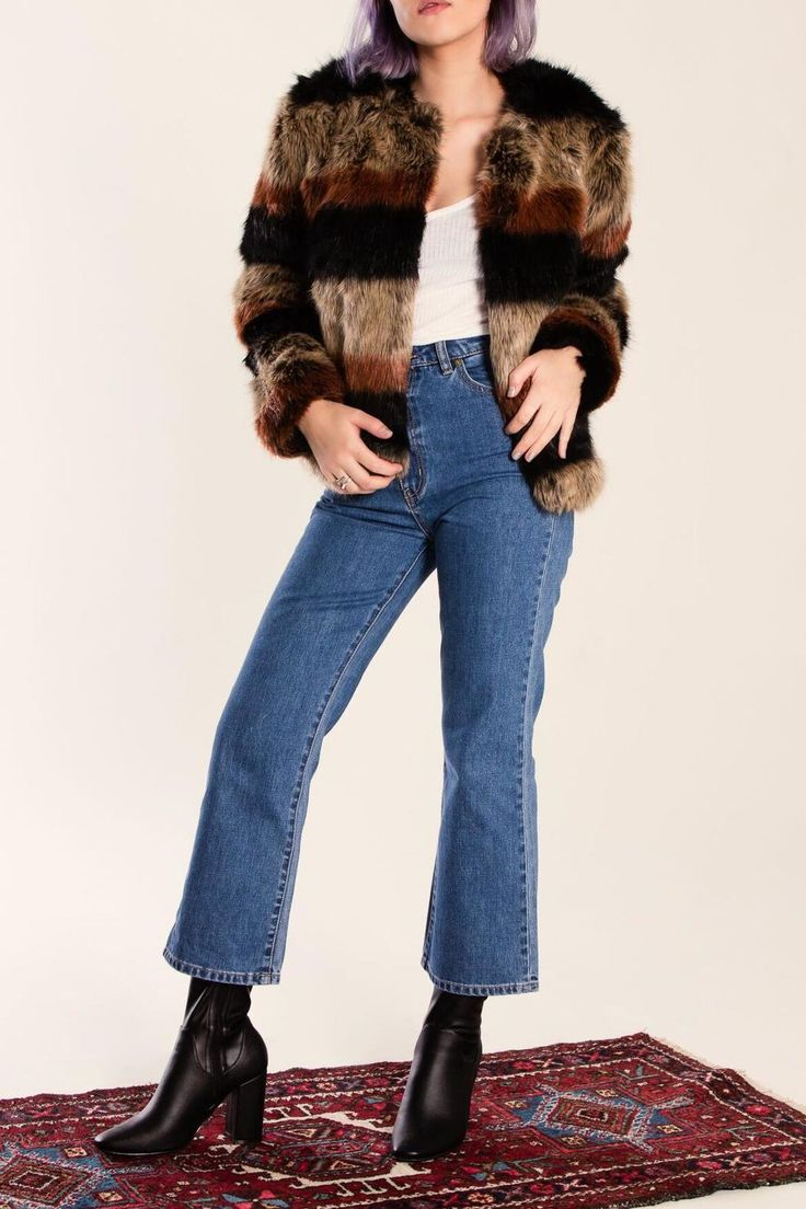 Make a statement while staying warm in this 70's stripe plush soft faux fur coat. Lined long sleeve open placket with pockets. Pair with a velvet mini dress for nights out or with your favorite jeans for a casual day. Stripe Fur Jacket by Tularosa . Clothing - Jackets Coats & Blazers - Faux Fur & Fur California