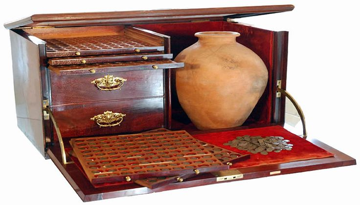 Coin cabinet with space for other ancient artifacts, e.g. Roman coins and a Roman vase.