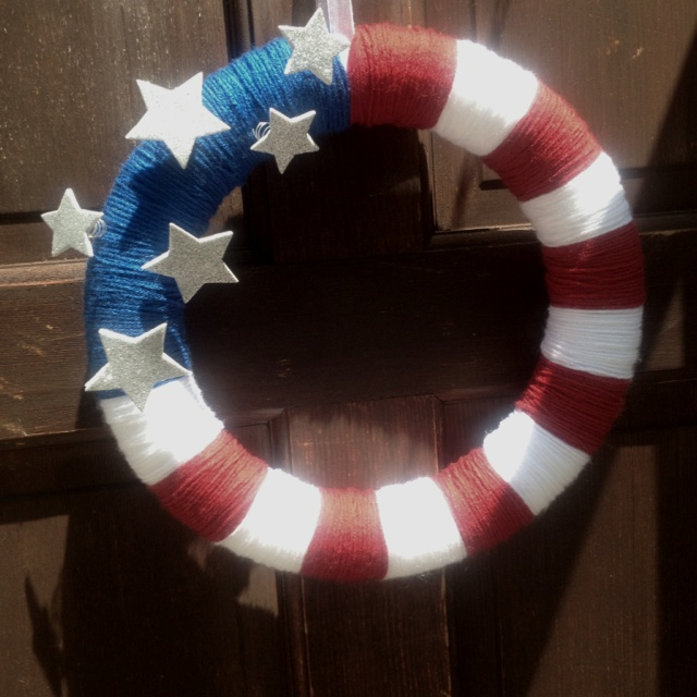 4th of July wreath!  Yarn wrapped wreath, glitter stars on wire poked into the styrofoam. Easy!!