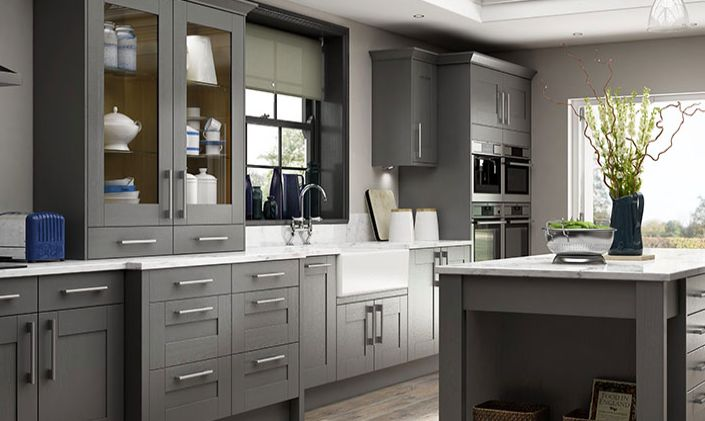 Wickes Tiverton Slate cupboards and Lyskam White Quartz worktop, plus butler's sink and chrome taps