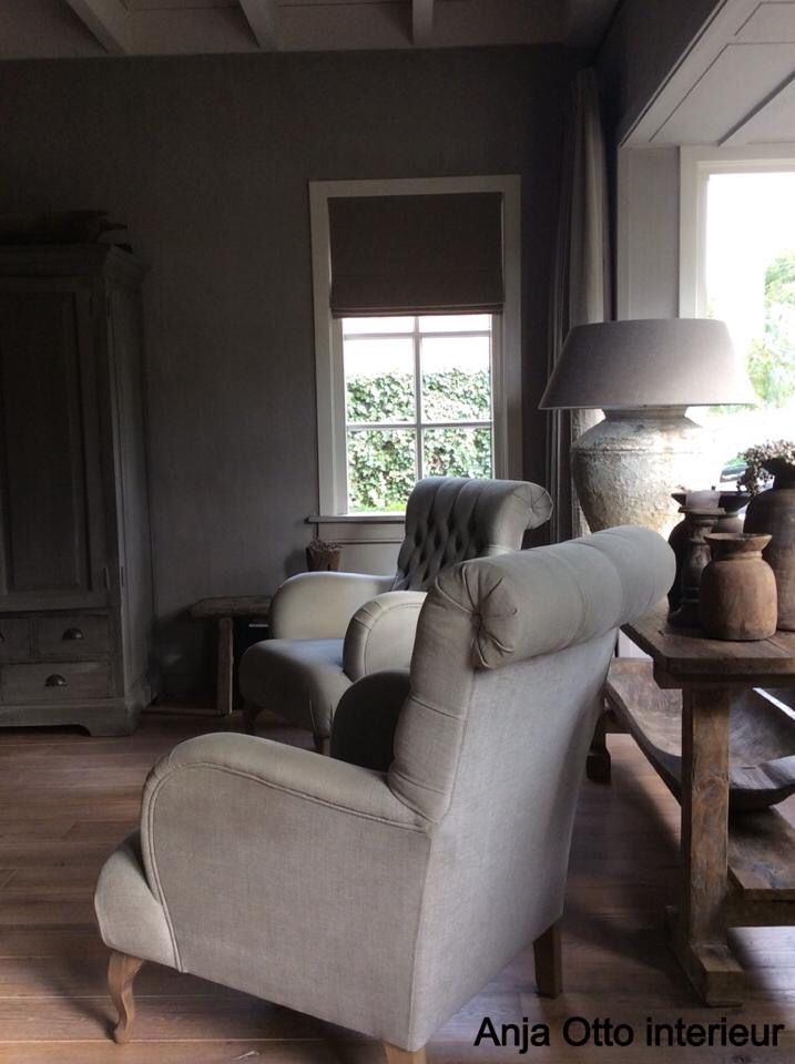 **1** the 2 chairs and side table against the window.