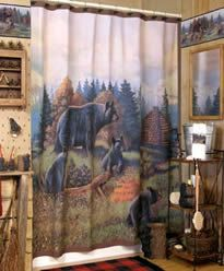 All the accessories to decorate your bath in a rustic, bear theme. The Black Bear Lodge shower curtain features a black bear and her three cubs enjoying a day in the meadow.