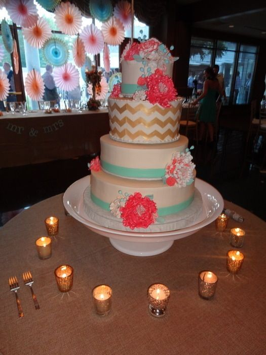Coral and mint wedding cake with gold chevron