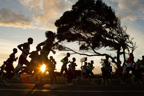 People run during The Old Mutual Two Oceans Ultra Marathon on March 30, 2013 in Cape Town, South Africa.