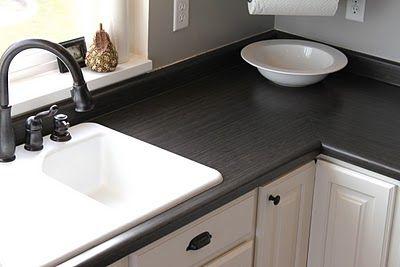 "Alternative to granite countertops?  Wilsonart laminate, Eastern Accents,  color ""Asian night."" Seen on http://casablancatransformation.blogspot.com/p/casablanca-tour.html."
