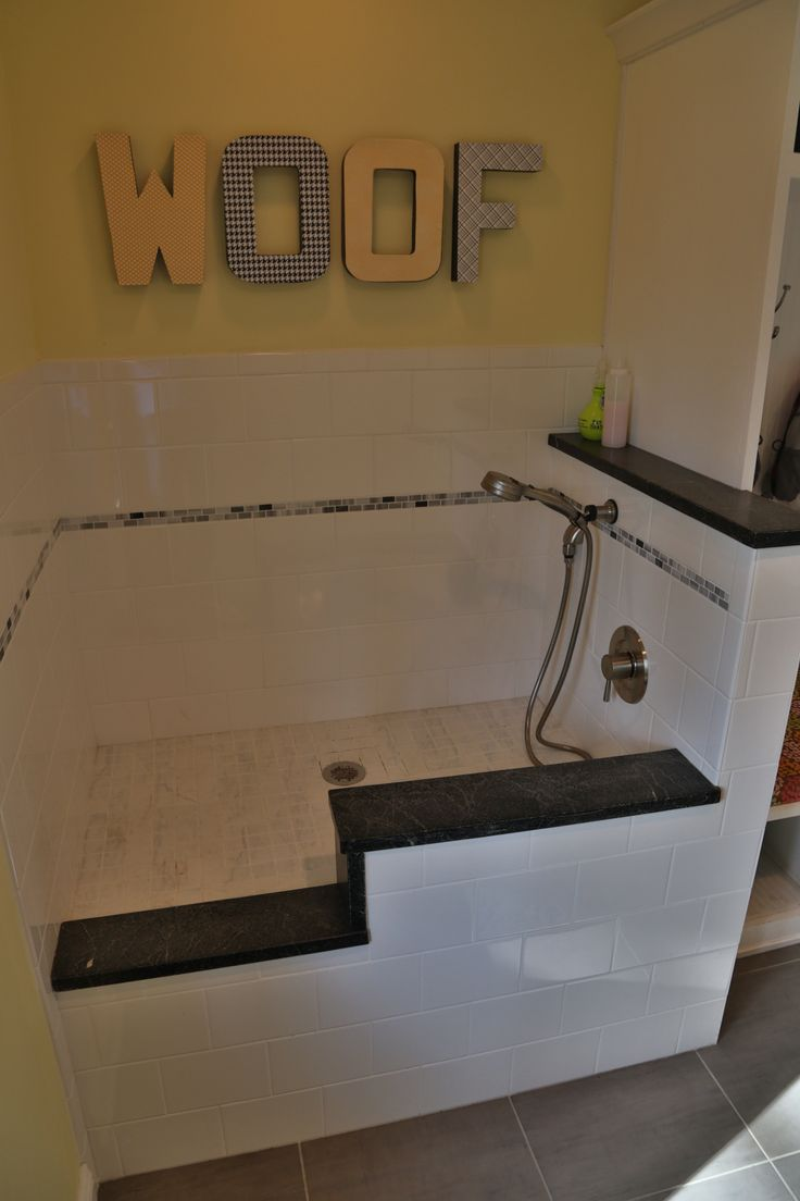 Dog bath in mudroom. Basic white tile and trimmed with leftover soapstone pieces from our kitchen counters. Tiled the floor as well to create a custom size (instead of using a shower base).