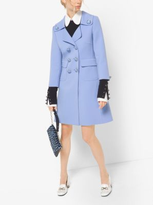 Cast in a happy sky blue hue, this refined coat shows a fearless feminine side. The clean crepe-broadcloth tailoring features cropped sleeves, notched lapels and a double-breasted button closure. Consider this tailored jacket the ideal counterpart to the season's whimsical, embroidered pieces.