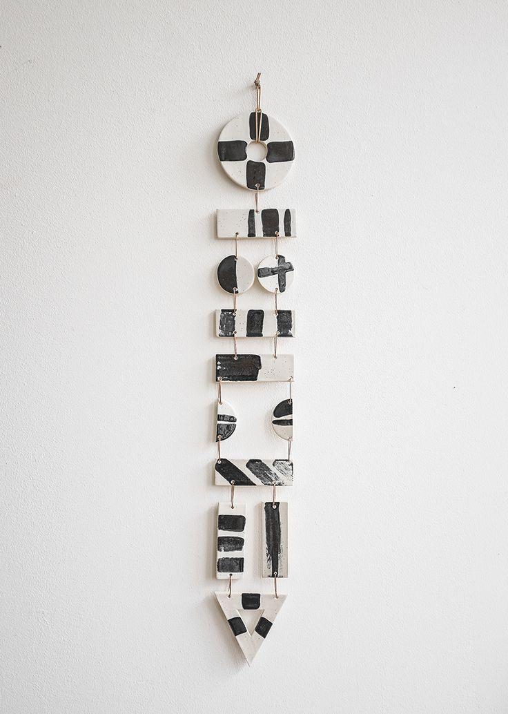 black and white ceramic hanging totem