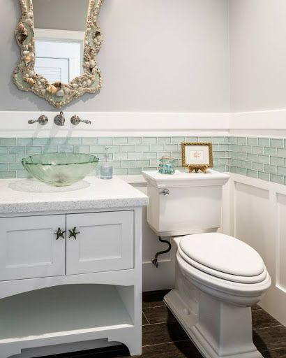 Coastal bathroom with shell mirror, glass bowl sink and cute starfish knobs on the cabinet. Featured on Completely Coastal: http://www.completely-coastal.com/2017/07/coastal-cottage-decor-blue-and-coral.html