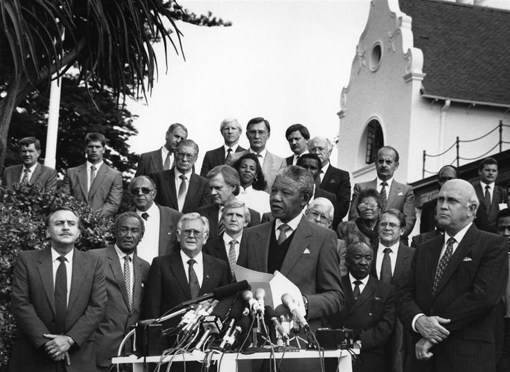 Mandela and FW de Klerk, right, address the media following breakthrough talks between the ANC and the government at the Groote Schuur Estate in Cape Town on May 5, 1990.