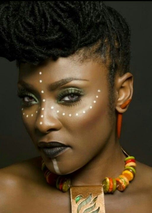 I love these photoshoots! Traditional African decorative face painting through an editorial sense