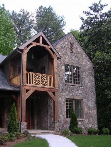 Absolutely love this field stone and cedar wood exterior.