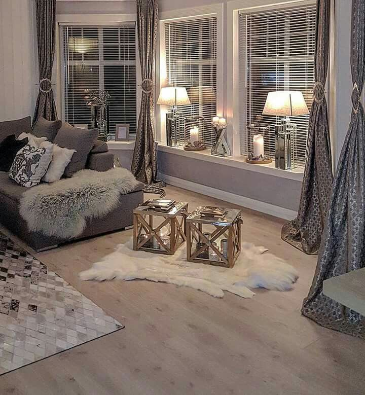 Add a caddy corner window to the corner nearest the front door and let them wrap around the front of the house in living room