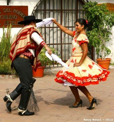 La Cueca is the national dance and folklore of Chile. This dance mimics the courtship of a chicken and rooster. The handkerchiefs you can see to the right symbolize feathers. Danced for years, la C...