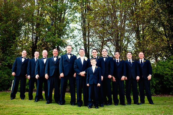 Groom has white vest and bow tie, groomsmen have black, and ushers have regular ties...maybe a good idea to set everyone apart. I can't decide!