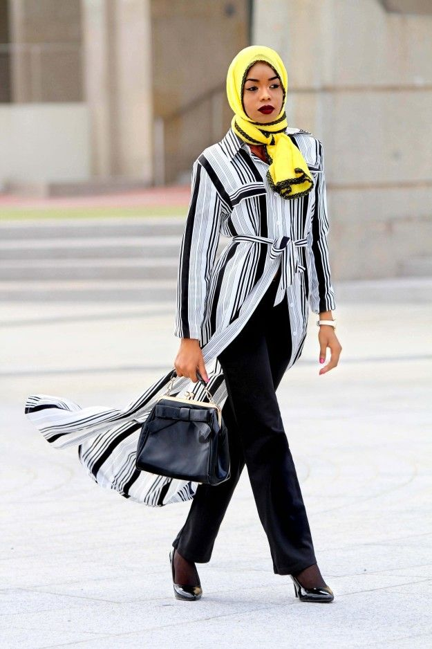A colorful hijab contrasting with a black and white outfit.