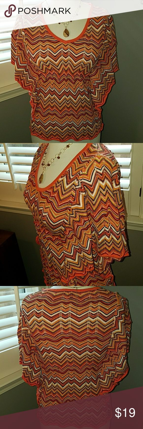 INC Flutter-sleeve coral, white chevron top Small Perfect for spring! Coral trimmed at hemline, along flutter sleeves, and v-neck. Coral, gold, brown, white, orange chevron pattern. (necklace not for sale) Cotton/rayon blend. INC International Concepts Tops