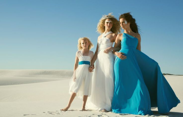 Infinity flower girl dress with lace overlay and blue sash, Infinity wedding dress with lace overlay, and our Infinity bridesmaids dress in Sky Blue.