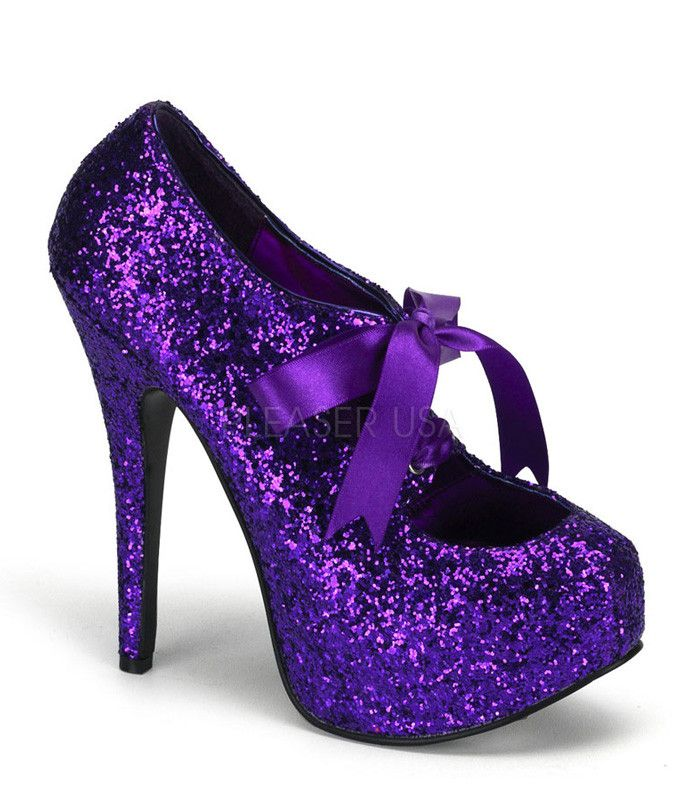 """Teeze pump in purple glitter has a 1 3/4"""" concealed platform. With a 5 3/4"""" heel and a purple ribbon tie at the top of shoe. Bordello Shoes offers a large selection of sleek to shiny patents, satin, s"""