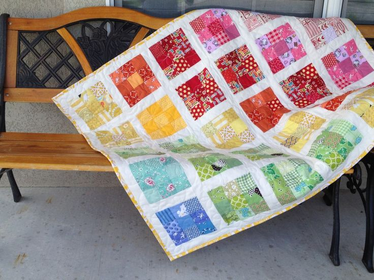 Worried about how to design the perfect baby quilt pattern? It's easy; just grab your most colorful fabric pieces and make a scrappy quilt pattern like this.