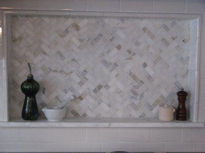 boxed shelf over range...with marble herringbone tile