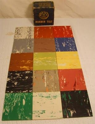 1950's linoleum tile ... my grandma had the cream and green tile in her kitchen for years.......the house I grew up in had the blue and white....lol