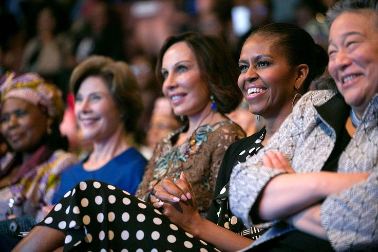 First Lady Michelle Obama watches a performance during a symposium program on advancement for women and girls in Africa, with U.S.-Africa Leaders Summit spouses…