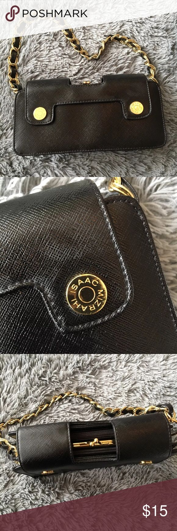 Issac Mizrahi target small black & gold clutch Super cute small issac Mizrahi for target purse. Perfect addition to a night out or a weekend away. Three compartments within the purse. Button closure and each compartment is either zipper or clasp. See photos for details. The gold emblem is slightly scuffed but not noticeable. Price firm Isaac Mizrahi Bags Clutches & Wristlets