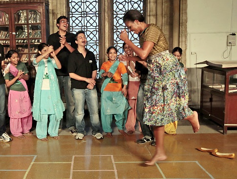 First Lady Michelle Obama plays hopscotch at Mumbai University with underprivileged children from India's Make A Difference charity, Saturday, November 6, 2010.