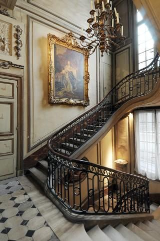 Staircase In a Parisian Hotel Particulier- love the framing on the wall!