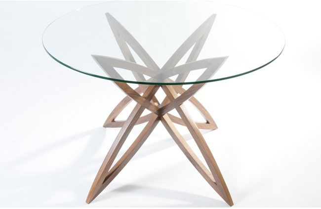 Glass top star table. Gives a feeling of space. Walnut base. #glass #star #interiordesign #table