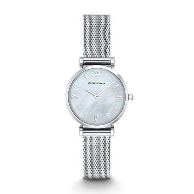Retro Watch The silver-tone mesh bracelet of this Emporio Armani women's watch keeps the focus on the white mother-of-pearl dial. The dial is…