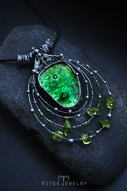 The Birth of Meteors Pendant necklace with a green fusing glass with bubbles, green seed beads (Preciosa Traditional Czech Beads) and faux peridot stones. By VitekJewelry
