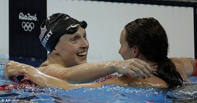 Carlin (right) hugs United States' gold medalist Katie Ledecky at the end of the race