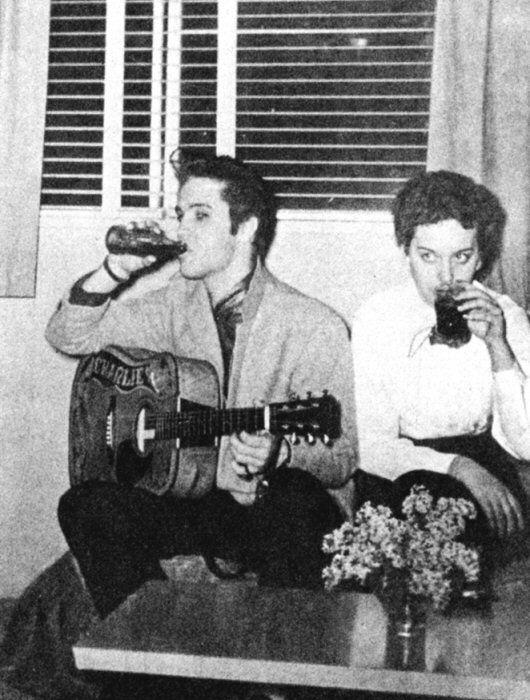 Elvis in St. Paul having cokes and practising his music1956