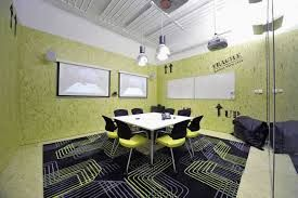 Conference room like inside the box, blue and green graphic design carpet