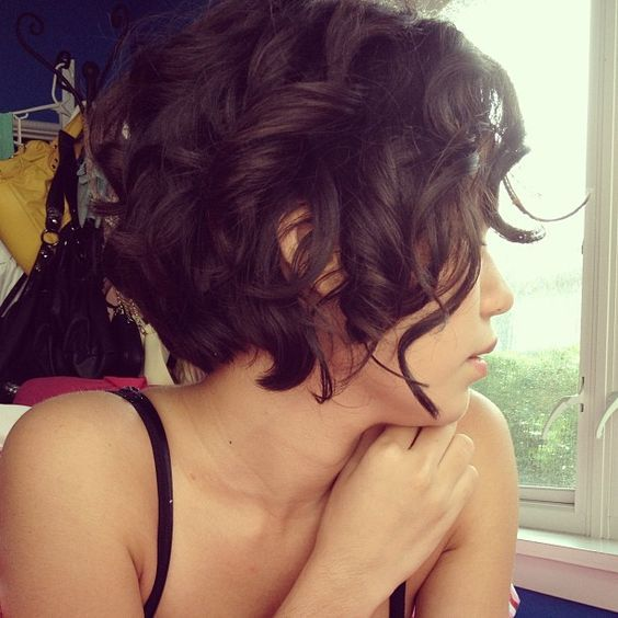 Trendy curly pixie haircut for women over 50