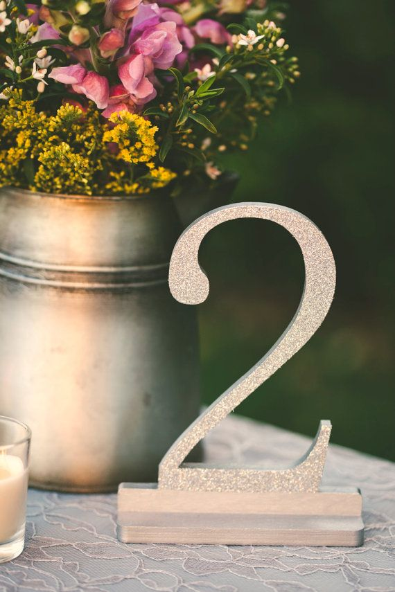 Your guests will have no problem finding their table with these large wood table numbers perched on their own integrated stand. Made from high