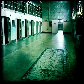 Alcatraz D-Block, known as the Treatment Unit was where men who broke the prison rules were placed into solitary confinement.  The hatchway led to a group of cells in the basement known as the Alcatraz Dungeon.