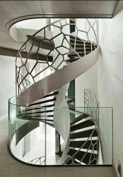 This staircase has a web like structure which could relate to nature or geometry because of the boxy shapes.