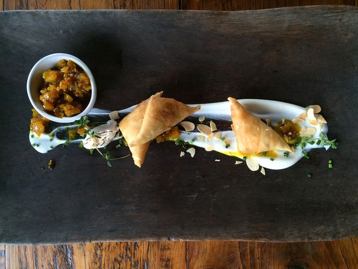 Cape Malay Kingklip Samosas laid on a bed of soft savoury meringue and pineapple & mango chutney.