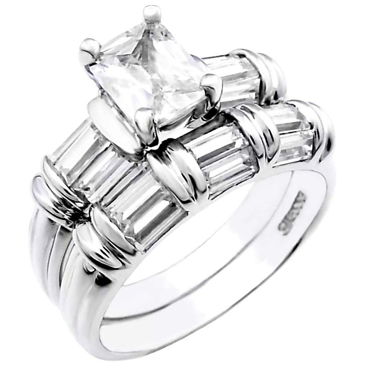 Trinity: An absolutely gorgeous and totally unique wedding ring set featuring a 1 carat Emerald-cut Ice on Fire Diamond CZ accented by baguette-cut Russian Ice