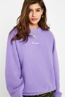 6cb61782 Check out Champion Script Logo Violet Crew Neck Sweatshirt from Urban  Outfitters