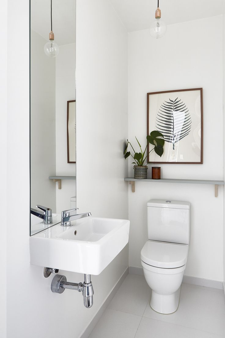 best 25 small toilet room ideas only on pinterest small toilet long mirror to elongate a small bathroom