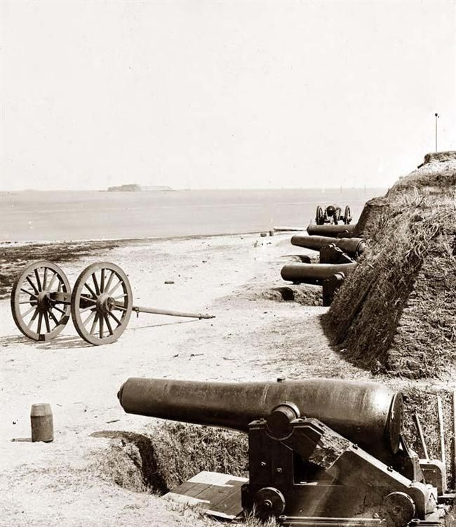 Battery of Confederate Fort Johnson,  Charleston, S.C., with Fort Sumter in the distance, 1865.